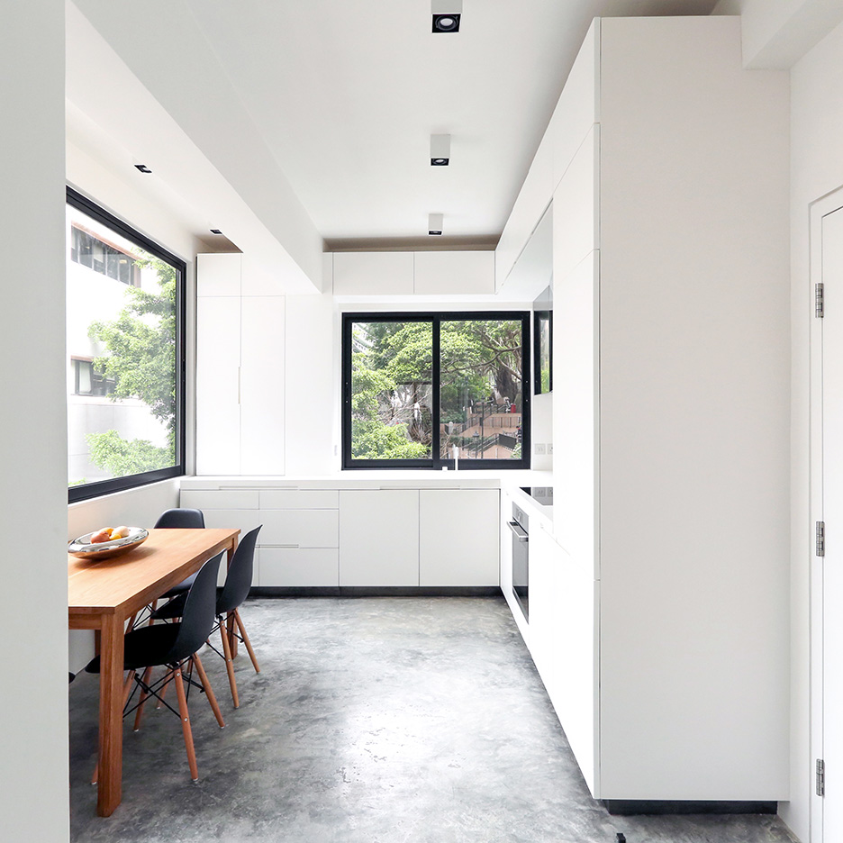 H-residence, rocker lange architects, Hong Kong, Minimal interior design, refurbishment of old walk-up building, L-shape kitchen made of Corian, with concrete floor finish